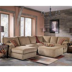 THIS is what I want for the den!! sectional sofa + ottoman