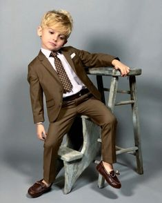 Our Boys' First Class Slim Fit Suits are made and designed for kids. Comfy and Modern with a killer tailored fit for kids of all ages.   #borntotrend