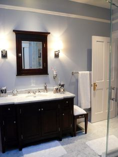 It looks like a bluish-gray tone - similar to Feather Soft 1431 by Benjamin Moore.