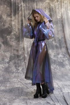Psychedelic Hooded Coat Look Psychedelic Hooded Coat in a Transparent Holographic Silk with Metallic Thread. Handmade in our NYC Atelier by our in-house seamstress. Fits sizes Custom sizing, fabric, and color is possible. Please contact us a Space Fashion, Fashion Design, Fashion Runway Show, Img Models, Inspiration Mode, Shows, Rain Wear, Costume Design, Ideias Fashion