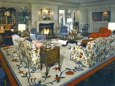 Custom rug colors are used to set the color scheme in the rest of the room. Nice antiques & art warm this room.