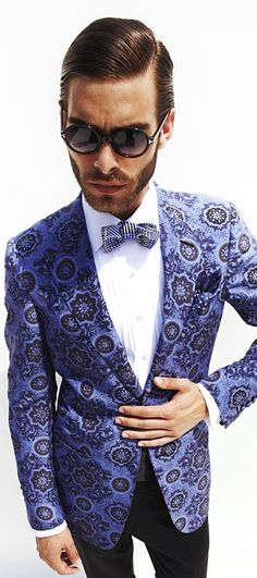 The statement this bow tie,blazer combo makes is loud and clear: Bold and Beautiful