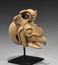 Maya Culture, Guatemala, ca. 550-950 CE.  Depicting a God, most likely Chaac the Maya rain deity. With his lightning axe, Chaac strikes the clouds and produces thunder and rain.