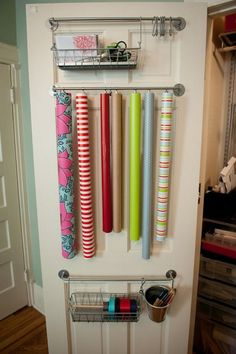 wrapping paper organization - not bad considering my space constraints.  i don't want the rolls dangling in space, though, since this would be on a heavily used door.