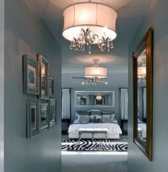 What a lovely hallway with photos on both sides leading to the bedroom. Lets the master bedroom make a grand entrance.