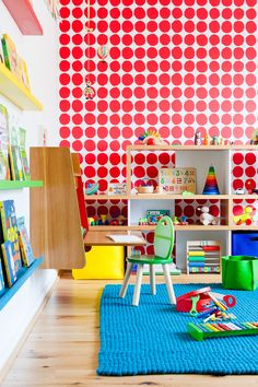 Fantastic Marimekko wallpaper brings instant impact to this child's bedroom designed by colour + shape, the perfect space to inspire a creative young mind with ample room for trendy toys and beautiful books.
