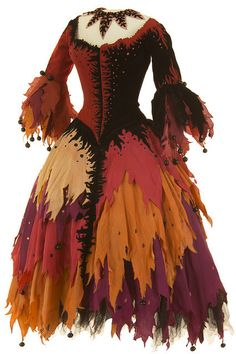 Costume from Opéra Comique, 1958 theater wardrobe 50s 60s fall orange red yellows rag full skirt