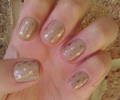 Nude base with gold glitter polka dots. Festive!