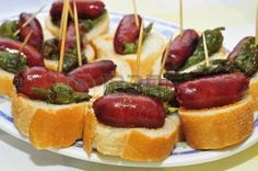 Picture of closeup of a plate with spanish pinchos made with chorizos an Padron peppers stock photo, images and stock photography. Tapas Spain, Tapas Party, Chorizo, Chicken Salad Recipes, Tostadas, Sushi, Sausage, Spanish, Chips
