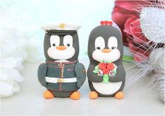 FOUND MY WEDDING CAKE TOPPER!!!!      Wedding cake toppers Military Penguins - Marine Army dress blue jacket - with hat. $131.00, via Etsy.