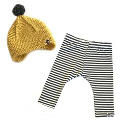 This bamboo cotton baby line runs true to size. Bamboo Cotton will shrink in the dryer. This set includes: one hand knitted warm pom beanie, and one pair of bamboo leggings Striped Leggings, Hand Knitting, Mustard, Winter Outfits, Winter Hats, Beanie, Rompers, Cream, Neutral Outfit