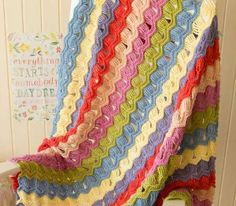 The English Cottage Crochet Fan Pattern is a breath of fresh air! A classic ripple crochet pattern is given a unique, lacy twist. | AllFreeCrochetAfghanPatterns.com