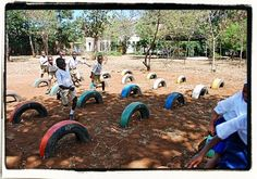 Our Alternative Learning project - making learning fun! The Learning Landscape is a scalable, tyre grid system for primary education built using old tyres and bright paints. Children are asked questions and must find the tyre with the correct answer - simple and effective! Outdoor Education, Outdoor Learning, Outdoor Play, Fun Learning, Bright Paintings, Old Tires, Primary Education, Play Spaces, Grid System