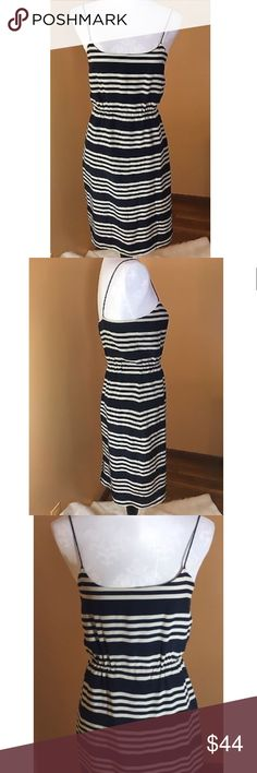 """J. Crew Sailor Stripes Silk Dress J. Crew silk dress in navy and ivory stripe. 100% silk, fully lined, spaghetti straps and elastic at waist for a flattering shape. Super comfortable and versatile- easily goes from office to happy hour! Lying flat length from top of strap to hem is 38"""", elastic waist lying flat unstretched measures 13"""". EUC, no flaws! J. Crew Dresses"""