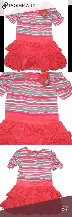 Little Lass 12 Month Coral Knit and Lace Dress Gently used Little Lass 12 month dress.  Short sleeve sweater knit material on the top.  Rosette detail on neckline.  Grey, silver, pink coral and white striped.  Coral lace tiered skirt.  It is lined with smooth material underneath.  Very cute dress! Little Lass Dresses Casual