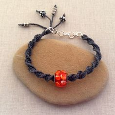 Free tutorial to make the macrame bracelet and a frame that makes macrame knotting super quick and easy: Modernizing Macrame with Large Hole Beads at Lisa Yang's Jewelry Blog: