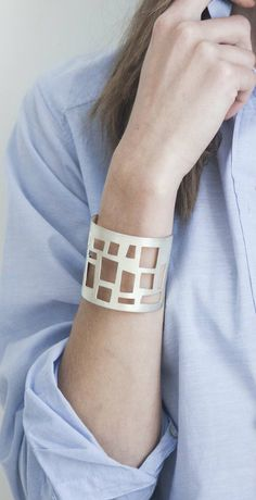 Visibly Interesting: Sheri Beryl modern geometric cuff bracelet in satin finish Sterling Silver plated Copper. Hand shaped and cut in heavy gauge Copper so no two are alike, then plated in Sterling Silver. Handcrafted in Los Angeles.