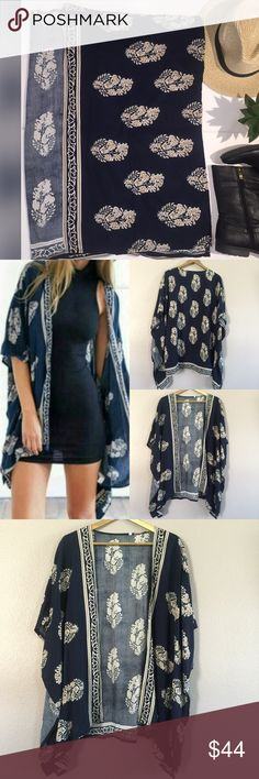 Boho Chic Kimono Beautiful navy blue with leaf drown and cream design. For great on a Small or Medium  ✅ will bundle 👌🏼✅🚭 ✅ all reasonable offers will be considered 👍🏼 🚫No Trading 🙅🏻 Poshmark rules only‼️ 📝Measurements taken laying flat                            Ⓜchest. Armpit to armpit 23 Ⓜ️length 28 Boutique  Sweaters Cardigans