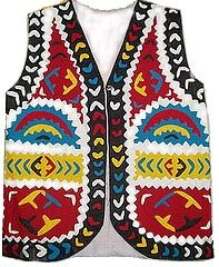 This handmade cotton waistcoat that we make on order. It is a traditional hand appliqued piece. Contact us for more details on email: ralliquilt@gmail.com