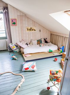 amazing child's room in the attic...This floor would be awesome in my kids' bedrooms. I LOVE the blue!