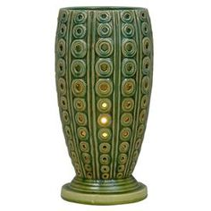 Weathered ceramic table lamp with a tiered pedestal base and openwork detail.    Product: Table lamp  Construction Material: Ceramic   Color: Green  Features: Three way switch  Accommodates: (1) 100 Watt medium bulb - not included  Dimensions: 14 H x 7 Diameter