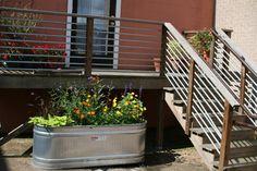 metal trough planter in a parking spot