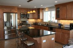 Traditional maple kitchen with island. Similar to my layout. Do I get black counter tops or cream? Maple Kitchen Cabinets, Kitchen Cabinet Design, Kitchen Redo, New Kitchen, Kitchen Remodel, Kitchen Dining, Kitchen Designs, Kitchen Ideas, Kitchen Layouts