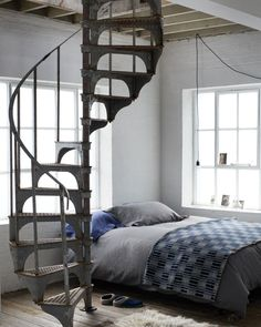 Toast HouseandHome - AW13 October 64 / 103 - Photograph by Nicholas James Seaton - www.toast.co.uk  Love the industrial fire stairs, soft bedlinnen en the loft windows