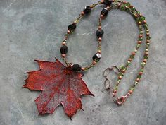 Elegant Sugar Maple Leaf in Iridescent Copper with a variety of fancy faceted Czech glass stones, Swarovski crystal, copper glass, glass seed beads qand large two tone dark amber and olive green