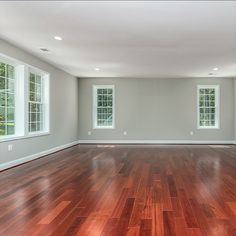 Owner's suite with hardwood flooring, gas fireplace and custom dual walk-in closets with built-in's. Listed for $1,350,000 in Oakton, VA by The Casey Samson Team is a Wall Street Journal Top Team in Northern Virginia.