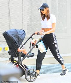 Irina Shayk shows off toned abs in white crop top as she takes daughter Lea out for walk Celebrity Photographers, Toned Abs, A Star Is Born, Irina Shayk, Celebs, Celebrities, Minimal Fashion, Sport Fashion, Supermodels