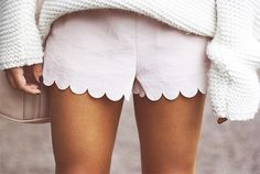 Scalloped shorts and a cozy sweater.