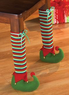 Set of 4 Holiday Elf Chair Leg Covers - Give your home an extra– and totally unexpected, bit of holiday charm when you dress up a chair or table's legs with these colorful elf covers. Set includes 4 skid-resistant slipcovers that are colorful, whimsical and laugh-out-loud fun! $14.99  Link    #Christmas