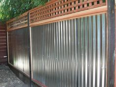 Wood with Galvanized Tin « Arbor Fence Inc Cheap Privacy Fence, Privacy Fence Designs, Patio Fence, Backyard Privacy, Diy Fence, Bamboo Fence, Backyard Fences, Fence Ideas, Arbor Ideas