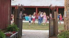 Guests at the church party dance, as seen from the alley-way between the Middle Barn, left, and the Wedding Barn, right at Westwoods' Civil War Ranch. (Pictures by Lena & Leif Baron)