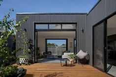Use of colourbond cladding in black, with black windows and deck from the Brunswick Extension House Cladding, Exterior Cladding, Facade House, Metal Building Homes, Building A Deck, Building Ideas, Modular Homes, Prefab Homes, Timber Deck