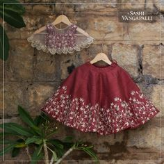 Sashi Vangapalli special maroon blossom flared baby gown paired up with a embroidered border sheer cape.now you can style up your princess with Sashi kids collection only on order : ping on what'sapp - 7993483640 07 July 2018 Girls Frock Design, Baby Dress Design, Kids Lehanga Design, Kids Indian Wear, Kids Ethnic Wear, Kids Dress Wear, Kids Gown, Baby Frocks Designs, Kids Frocks Design