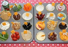 Alphabet Food Tray,Here is what we had:  A=Apple Juice, B=Broccoli, C= Carrots, D=Dip, E=Egg (hard boiled), F=Fruit-by-the-Foot, G=Graham Crackers, H=Hershey's, I=Ice, J=Jerky, K=Kisses, L=Legos, M=Mini Marshmallows, N=Nuts, O=Olives, P=Peaches, Q=Quesadilla, R=Raisins, S=Snap Peas, T=Tomatoes, U=Unleavened Bread, V=Vanilla Pudding, W=Whoppers, X,Y, Z=XYZ Crackers!