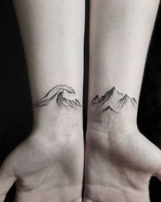 Matching wave and mountain tattoos on the inner wrist. Tattoo artist: Stella Luø