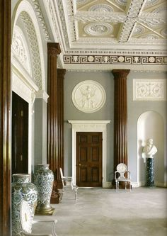 "Comments from blog : ""The entrance hall at Harewood House, 1759, designed by Robert Adam. Photographer: Paul Barker  The painted Hall chairs with their Neoclassic ornament are by Thomas Chippendale. The hall shows Adam's concern for classicism, with a unified interior of engaged columns, plaster reserves with flattened reliefs, and a running Greek Key frieze.""-PB"