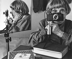 "Ilse Bing    Still the ""Queen of the Leica""    With this photograph, Avant-garde photographer Ilse Bing (1899 - 1998) pays homage to an earlier self portrait of the same composition, using her signature Leica camera."