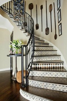 A mix of vertical objects displayed on the stairwell balances the design