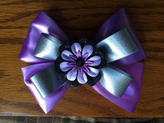 A personal favorite from my Etsy shop https://www.etsy.com/listing/279315462/6-inch-purple-and-grey-stacked-bow