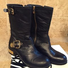 Vince Camuto Moto boots Very stylish Vince Camuto Moto boots with gold accents.  Boots have gold side buckles, gold accent at the heel and gold side zip.  In very good condition.  Only worn a few times. Vince Camuto Shoes Combat & Moto Boots