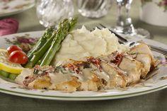 Your In-Law's Favorite Chicken   MrFood.com - sautéed chicken breasts with white wine, cream, and sun dried tomatoes