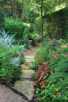 This stepping-stone path breaks off from the main entry walk, inviting you around the corner and into the main garden.