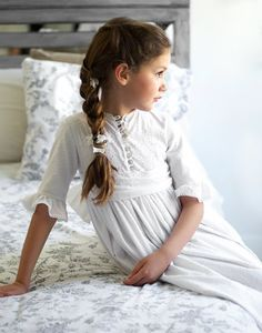 Take a photo of child in pretty gown the night before first communion, maybe even saying bedtime prayers kneeling at bedside