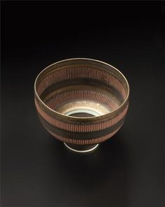 Footed bowl, Porcelain, golden manganese, terra cotta and turquoise glazes, two bands of vertical sgraffito repeated inside and out. 4 in. (10.2 cm.) high, 5 1/4 in. (13.3 cm.) diameter, c.1978