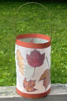 Leaf Lantern - found this in a wonderful book called Earthways. You press autumn leaves and then iron them between two sheets of waxed paper to make the lantern sides. Glue construction paper strips on top and bottom, and hot glue to the base of a round oatmeal or ice cream container.