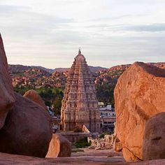Ever thought what it would be like living in Fred Flintstone land - check Hampi out. Have a fond memory of getting lost here, few miles out of Hampi and getting re routed back by a Nomad guide who just appeared! Hampi India, Alien Theories, Unique Buildings, South India, Ancient Aliens, India Travel, Incredible India, Goa, Tower Bridge